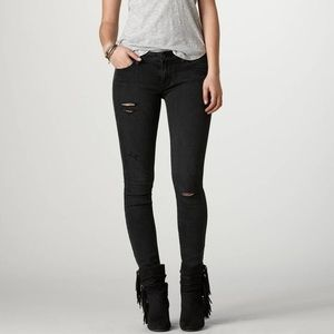 American Eagle distressed black jeggings.